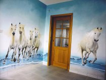 Trompe-l'oeil with horses of the Camargue in a hall.