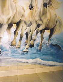 Close up on the legs of the horses and the waves invading the hall.