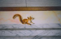 Squirrel of our wood on a pediment in imitation hones marbled.