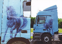 Tuning truck: cabin decorated by a painting personalized with pulled up horse.