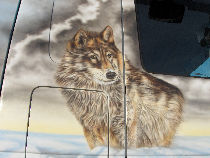 "A large plan on one of the many wolves of this painting personalized on truck. "" /></a>  